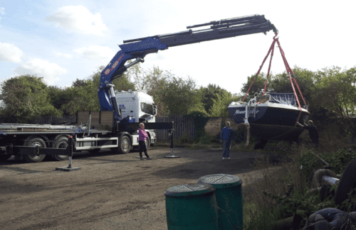 SG Haulage lorry lifting a boat