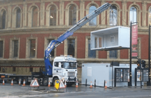 Truck lifting a container