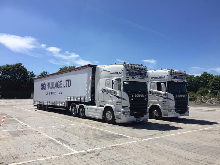 Two Side-on SG Haulage Road Trucks
