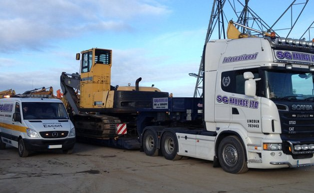 Parked truck, digger and van
